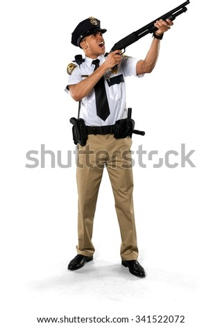 Angry African young man with short black hair in uniform using shotgun - Isolated - stock photo