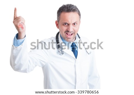 Angry aggressive doctor or medic threatening with syringe isolated on white background - stock photo
