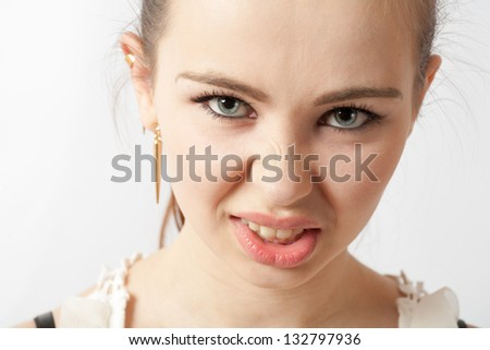 Angry american teenager face and shoulders over white background. Anger concept. - stock photo