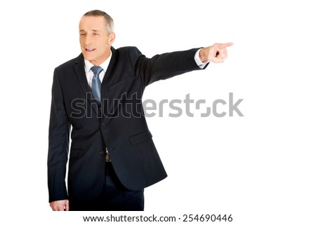 Angry and frustrated boss dismissing someone. - stock photo