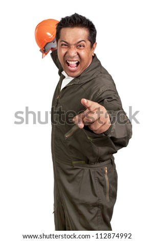 angry architect with helmet and architectural plans - stock photo