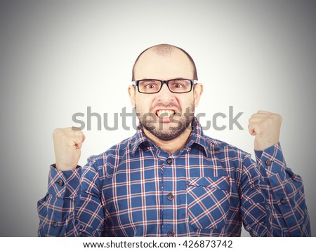 Angry bald man in glasses.  Isolated on a white background.  - stock photo