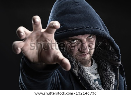 Angry bandit tries to grab you - stock photo