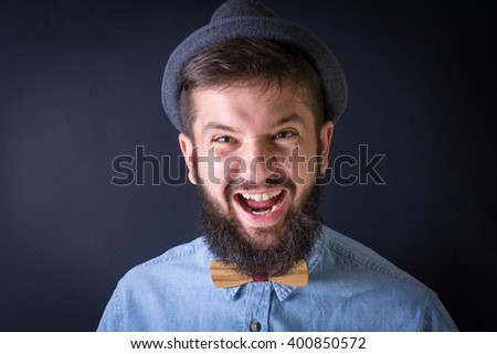 Angry bearded man yealing in a blue shirt