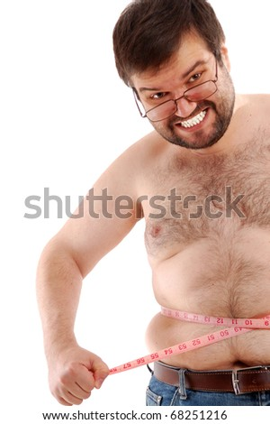 angry big man measuring his belly against the white background - stock photo