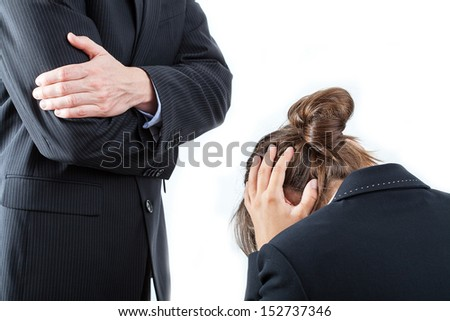 Angry boss and the worker opposite him - stock photo
