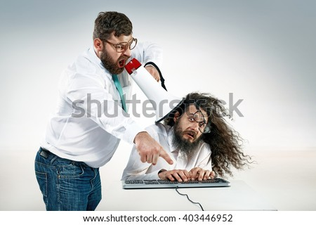 Angry boss yelling to a office worker - stock photo