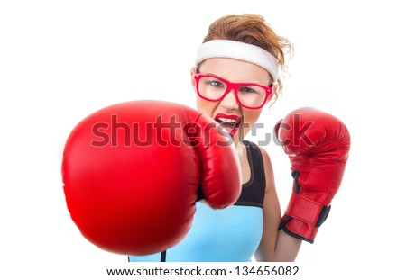 Angry boxer - fitness woman boxing wearing boxing gloves, focus on face - stock photo