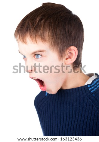 Angry boy wearing blue sweater shouting on white background - stock photo