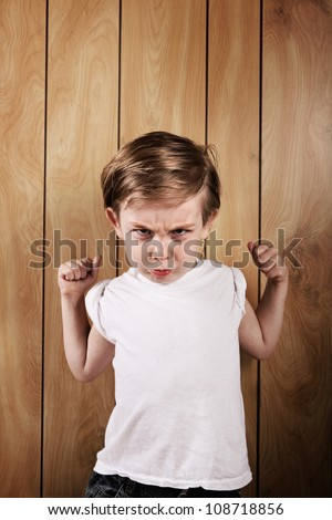 Angry Boy with clenched fists - stock photo