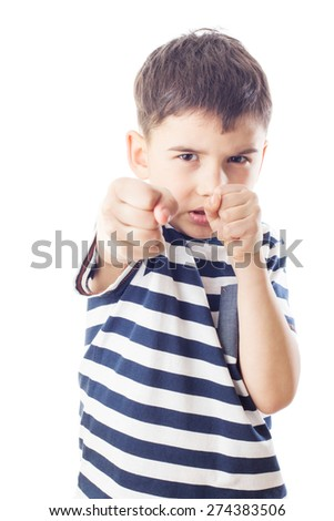 Angry boy with fists up, ready to fight - stock photo