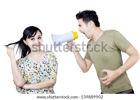 Angry boyfriend using speaker isolated on white background