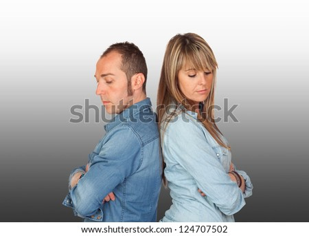 Angry boyfriends fought with a grey background - stock photo