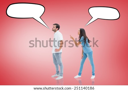 Angry brunette shouting at boyfriend against red vignette - stock photo