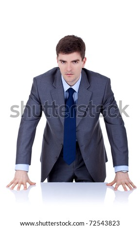Angry business man behind the desk , over white - stock photo