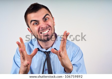 Angry business man expressing frustration, portrait of young handsome businessman, concept of executive yelling, conversation problem communication crisis,anger,frustration.Room for text - stock photo