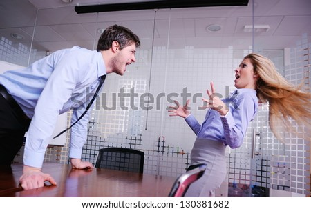 Angry business man screaming at employee in the office - stock photo