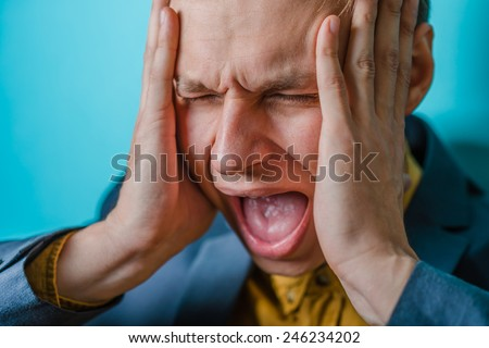 Angry business man screaming out loud at someone, portrait of young handsome businessman, concept of executive yelling, conversation problem communication crisis,anger,frustr ation - stock photo