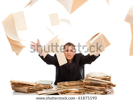 Angry business man throwing away lots of paperwork - stock photo