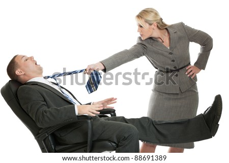 Angry business woman pulling the tie of a defensive business man isolated on a white background - stock photo