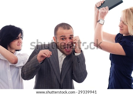 Angry business women fighting with a colleague - stock photo