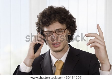 Angry businessman explains in the phone - stock photo
