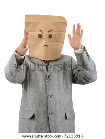 Angry businessman in paper bag on head isolated on white background. - stock photo