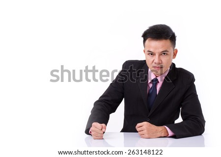 angry businessman looking at you