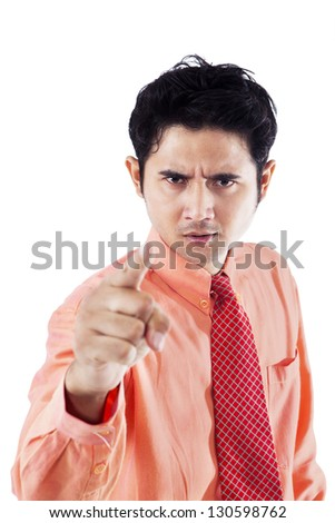 Angry businessman pointing at copy space, isolated on white - stock photo