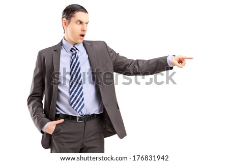 Angry businessman pointing with his finger, isolated on white background