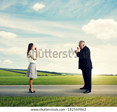 angry businessman screaming at mad businesswoman at outdoor