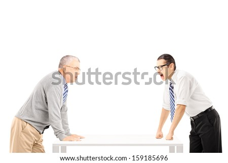 Angry businessman shouting at senior man isolated on white background - stock photo