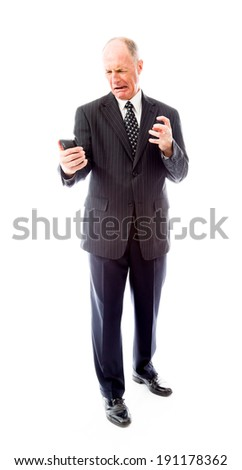 Angry businessman shouting on a mobile phone - stock photo