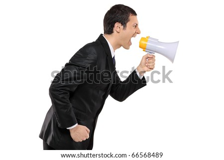 Angry businessman shouting via megaphone isolated against white background - stock photo