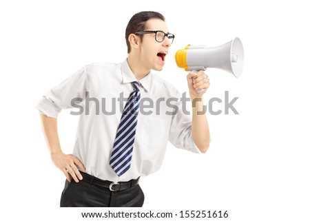 Angry businessman shouting via megaphone isolated on white background - stock photo