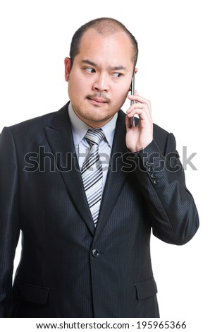 Angry businessman using mobile