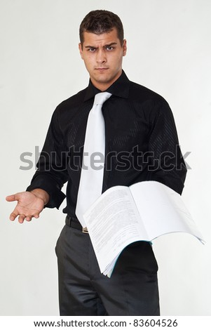Angry businessman with documents - stock photo