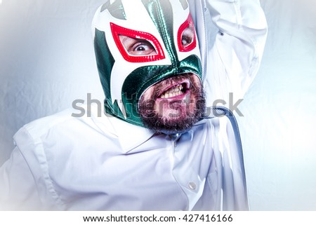 angry businessman with Mexican wrestler mask, expressions of anger and rage - stock photo