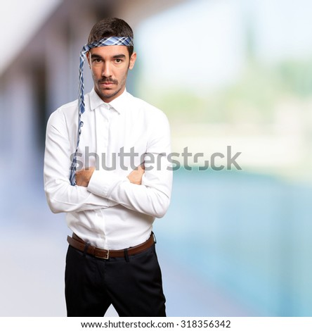 Angry businessman with tie on head