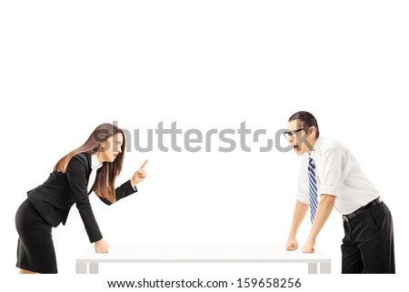 Angry businessman yelling at businesswoman who is threatening isolated on white background - stock photo