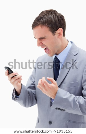 Angry businessman yelling at his cellphone against a white background
