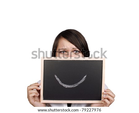 Angry businesswoman behind smiley face - stock photo