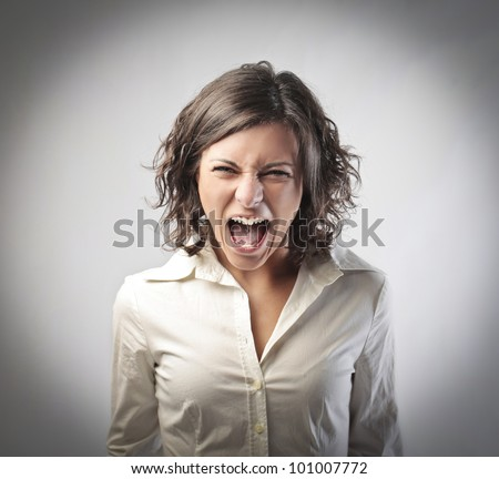 Angry businesswoman screaming - stock photo