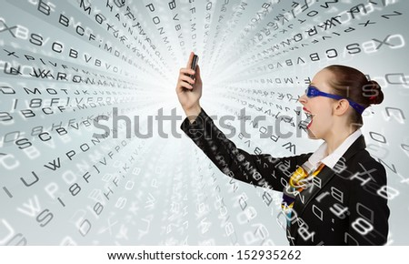 Angry businesswoman screaming aggressively in mobile phone - stock photo