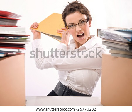 Angry businesswoman throwing documents - stock photo