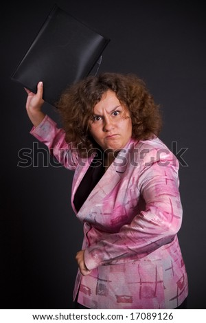 angry businesswoman try to hit you - stock photo