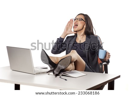 angry businesswoman with legs on the table command to others - stock photo