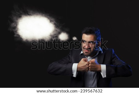 Angry caucasian business man in suit being, thinking to revenge against black background