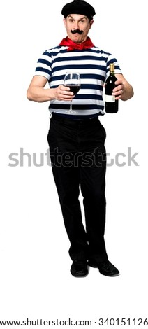 Angry Caucasian man with short black hair in costume holding wine bottle - Isolated - stock photo