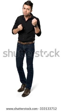 Angry Caucasian man with short dark brown hair in casual outfit being in boxing stance - Isolated
